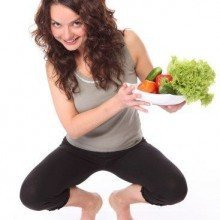 woman on scale with veggies