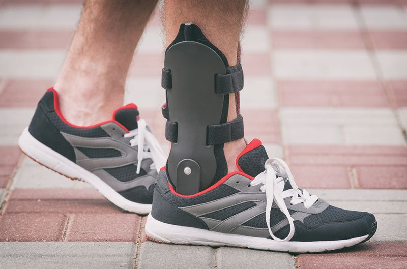 Man Wearing An Ankle Brace