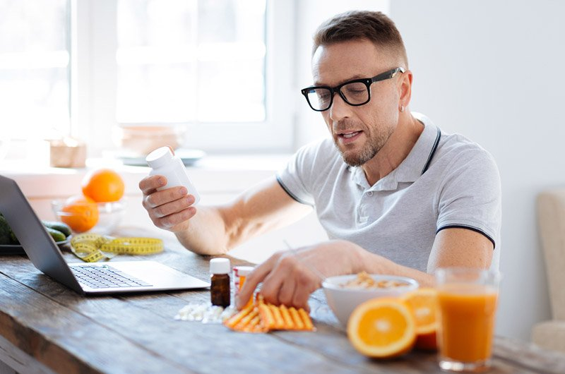 Man Making Pre-Workout Supplements Before Workout