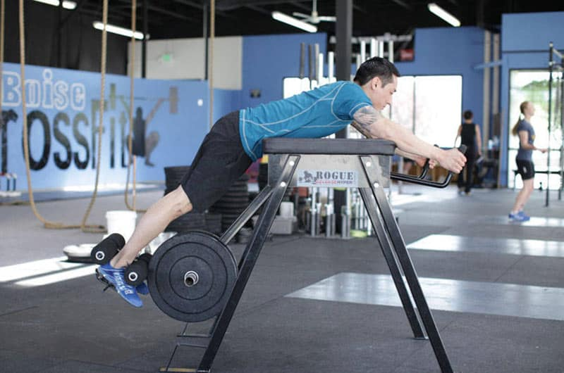 Man Working Out Reverse Hyperextension Machine