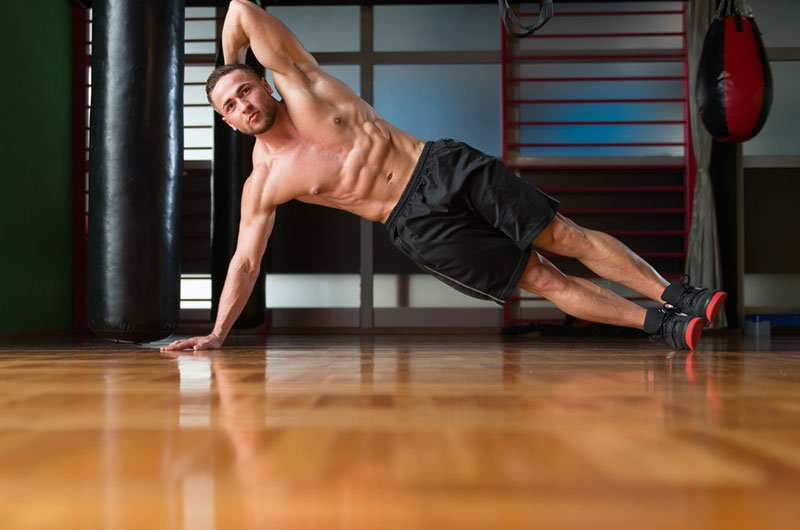 Man Doing Side Plank Crunch
