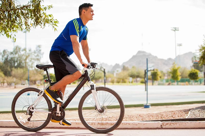 Man Using Road Bike For Fitness