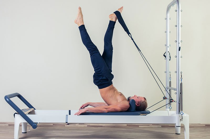 Man Using Stretching Machine For Fitness