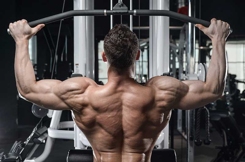 Muscleman Doing The Wide Grip Lat Pulldown Workout