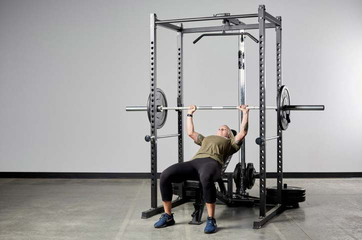 Woman Using Power Rack For Fitness