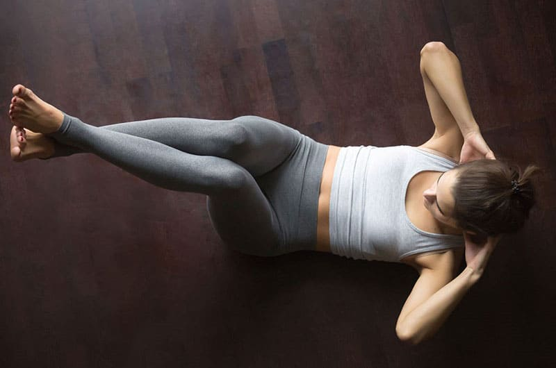 Woman Working Out Knee Crunches For Fitness