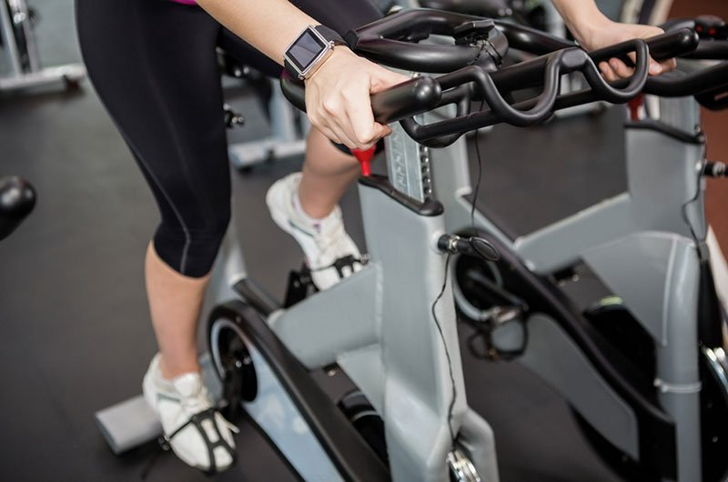 Woman Using Recumbent Bike For Health and Fitness